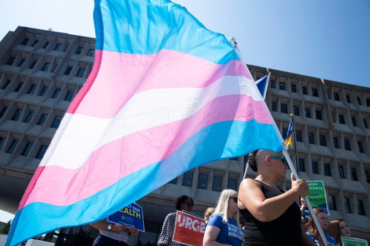 Transgender rights advocates protest outside the Department of Health and Human Services in Washington on Aug. 9, 2019.