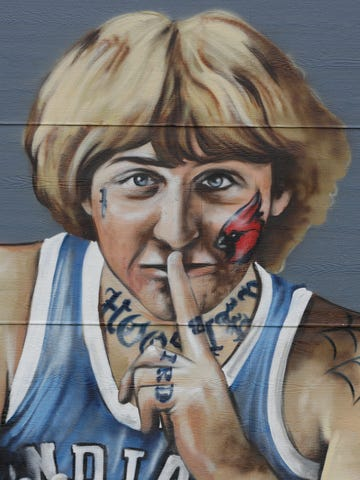 A mural of former NBA star Larry Bird is seen on the side of a multi-family residence in Fountain Square.