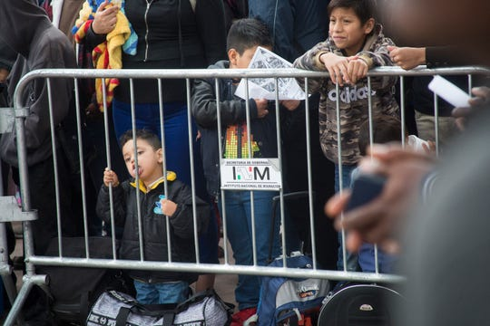 Hundreds of migrants, including children, make the daily ritual of visiting the El Chaparral port of entry in Tijuana, Mexico, to see which names will be called from a waiting list to petition for asylum in the United States. The migrants often wait weeks before their number is called.