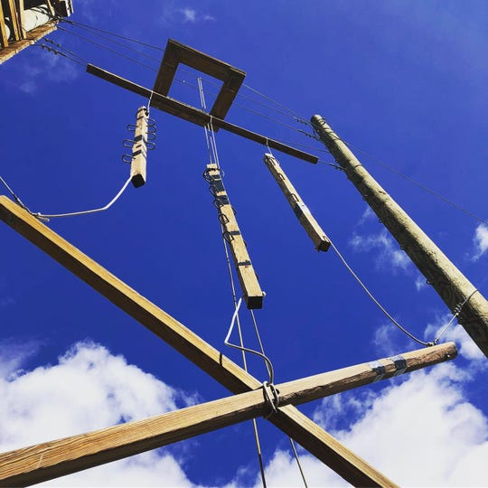 """With swinging ladders, a log bridge and a trapeze, the ropes course at C Lazy U dude ranch resembles a """"ninja training"""" camp."""