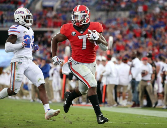 Georgia running back D'Andre Swift runs the ball into the end zone for a touchdown against  Florida during their game in 2018.