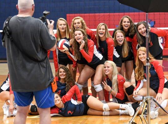 Photographer Chuck Hughes takes a photo of the team at Powdersville High School Thursday.