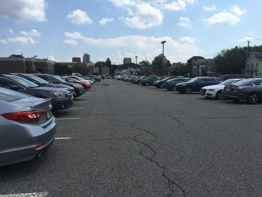 The modern-day view on the site of the old College Field: cars, cars and more cars.