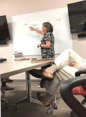 Wanda Greene participating in a debriefing with federal investigators. The photo was filed in federal court under her sentencing memorandum.