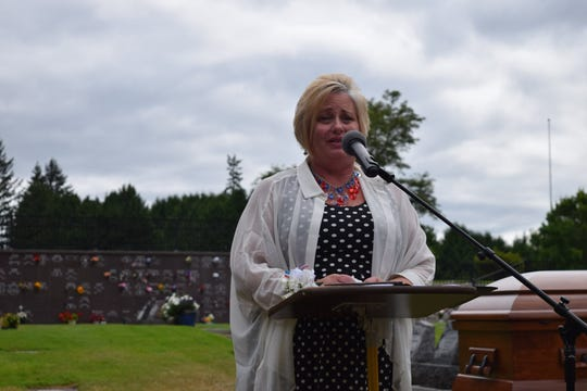 Helene Jensen, the niece of the Palmer brothers who died in Pearl Harbor, speaks at a memorial service on Aug. 9 at Sunset Lane Memorial Park in Port Orchard.