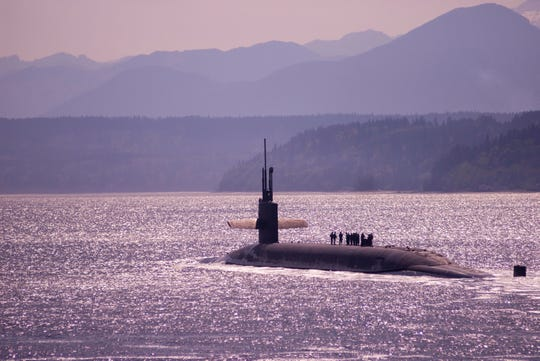 The Ohio-class ballistic missile submarine USS Louisiana transits the Hood Canal following a strategic deterrent patrol in 2018. The boat recently pulled in to the Puget Sound Naval Shipyard, where it will be refueled and complete a nearly three-year overhaul.