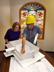 Rabbi Pat Hickman looks over model for new Temple Israel synagogue. FILE.