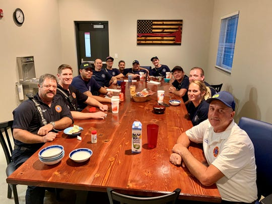 Firefighters from Shift A of the Rockledge Fire Department gather for family dinner at Fire Station 36 on Fiske Boulevard.