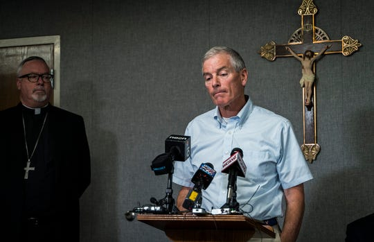 Center, priest abuse victim John Mahoney talks about a report he helped investigate that released the names of 40 priests accused of sexual abuse during a news conference on Thursday, August 22, 2019, in South Burlington. Left, Bishop Christopher Coyne, head of the Roman Catholic Diocese of Burlington, initiated the investigation looking into priest misconduct as far back as 1950.