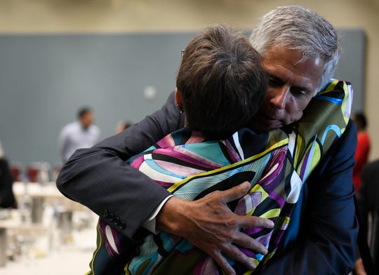 John Bell hugs Paulette Kluge, Thursday, Aug. 22, 2019. Kluge resigns as CEO of Corpus Christi Convention and Visitors Bureau.