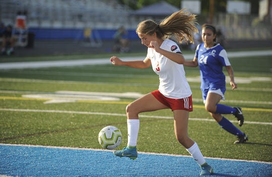 Bishop Rosecrans' Grace Wilson dribbles the ball during a 4-3 loss to Chillicothe at the Obadiah Harris Family Athletic Complex in Chillicothe, Ohio on Aug. 21, 2019.