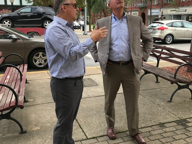 Chillicothe-Ross Chamber of Commerce President and CEO Mike Throne, left, talks to Ohio Treasurer Robert Sprague about the downtown revitalization effort in Chillicothe.