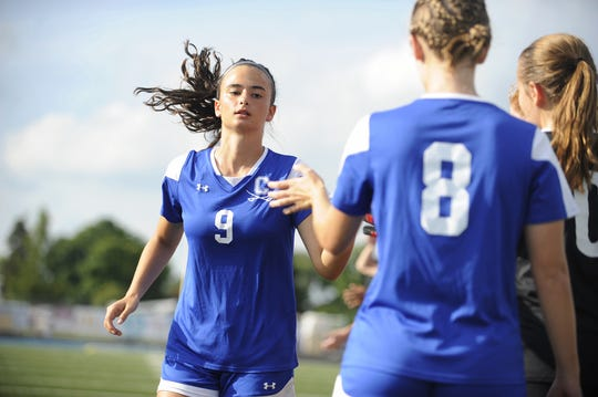 Chillicothe's Addie Erslan gives high fives before a 4-3 win over Bishop Roescrans at the Obadiah Harris Family Athletic Complex in Chillicothe, Ohio on Aug. 21, 2019.