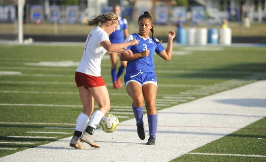 Chillicothe's Zoe Ford fights for the ball with Bishop Rosecrans' Allie Berry during the Cavs' 4-3 win at the Obadiah Harris Family Athletic Complex in Chillicothe, Ohio on Aug. 21, 2019.