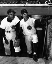 "APRIL 11, 1954: That's Right, Charley, Double Or Nothing: ""Looks invitin,"" third baseman Bobby Adams, right, was telling rookie Charley ""Chuck"" Harmon yesterday."
