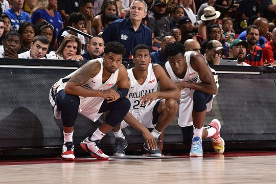 Trevon Bluiett #5, Aubrey Dawkins #24, Kavell Bigby-Williams #19 of the New Orleans Pelicans look on against the Memphis Grizzlies during the Semifinals of the Las Vegas Summer League on July 14, 2019 at the Thomas & Mack Center in Las Vegas, Nevada.