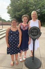 Kelley Elementary School fifth-grade students Kaitlyn Gripshover and Mollie Pidgeon and teacher Glenda Raney visit Arlington National Cemetery to place a wreath on behalf of the school Aug. 15 at the Tomb of the Unknown Soldier.