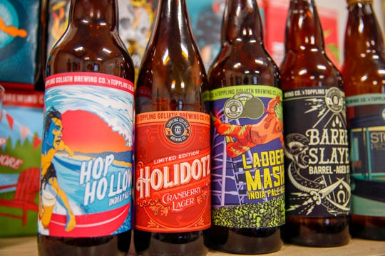 Beer labels designed by Sarah Hedlund, marketing director at Toppling Goliath Brewing.