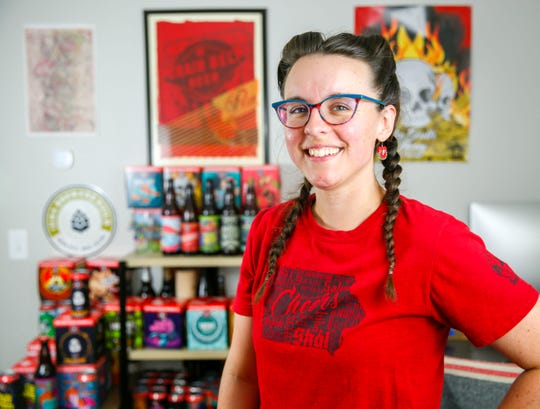 Sarah Hedlund, the marketing director at Toppling Goliath, is the brains and the talent behind the brewery's beer names and colorful cans.