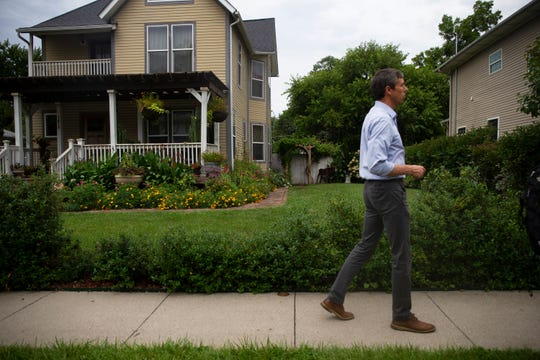 Democratic candidate Beto O'Rourke is invited into the home of Bob Baskerville in North Des Moines on August 21, 2019. O'Rourke campaigned door-to-door late afternoon before speaking at the Civic Education Block Party.