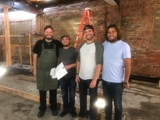 Chef Ben Siebert, operations manager Ryan Nicholson and corporate chef Ken VanMilligen pose with owner Alexander Hall inside the space of the new St. Kilda Cafe & Bakery currently being built in Valley Junction, West Des Moines.