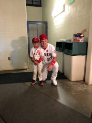 Los Angeles Angels center-fielder Mike Trout poses for a picture with Ashton Akers, a young Iowan recovering from cancer on August 19, 2019.