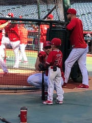 Ashton Akers speaks with his hero Mike Trout at Angels Stadium in Los Angeles on August 19, 2019.