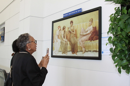 "This painting is called ""Reading the Story of Oenone.""  Lolita Haley, Wayne County arts authority board member, and State Rep. Leslie Love are viewing the art."