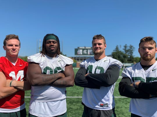 New MSU captains, left to right: Brian Lewerke, Raequan Williams, Kenny Willekes and Joe Bachie after practice Thursday, Aug. 22, 2019 in East Lansing.
