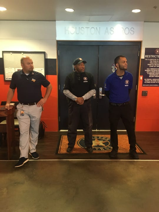 Houston Astros security officials stand in front of the clubhouse entrance on Wednesday, Aug. 21, 2019, in an attempt to prevent the Detroit Free Press from attending Justin Verlander's postgame media availability.