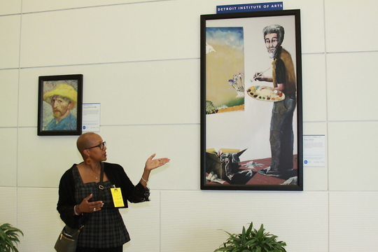 Sharon Harrell, DIA community engagement manager, explains Benny Andrews' Portrait of a Collagist.