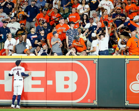 George Springer #4 of the Houston Astros watches a home run by Ronny Rodriguez #60 of the Detroit Tigers leave the park in the fifth inning at Minute Maid Park on August 21, 2019 in Houston, Texas.