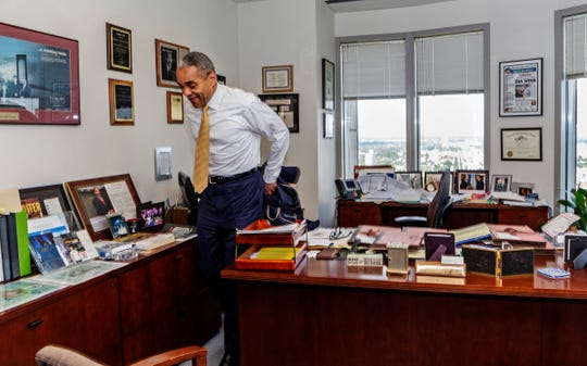 Reginald Turner Jr., this year's winner of the Neal Shine Award for Exemplary Regional Leadership, part of the Shining Light Regional Cooperation Awards, removes his jacket and gets down to work in his office at Clark Hill in Detroit on Sunday, Aug 18, 2019.