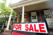 In this Aug. 16, 2019, photo a for sale signs beckon buyers to homes along Park Avenue in Richmond, Va. On Thursday, Aug. 22, Freddie Mac reports on this week's average U.S. mortgage rates.