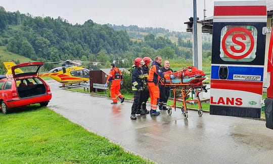 Rescue helicopter and ambulance have brought to hospital the first people injured by a lighting strike that struck in Poland's southern Tatra Mountains during a sudden thunderstorm, in Zakopane, Poland, on Thursday, Aug. 22, 2019.