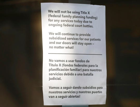 A sign is displayed on the door of Planned Parenthood in Salt Lake City Wednesday, Aug. 21, 2019.