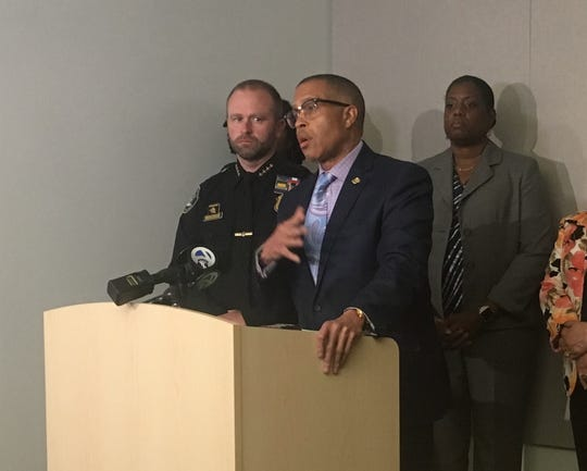 Detroit police chief James Craig addresses the media, flanked by assistant chief David LeValley and police board chairwoman Lisa Carter.