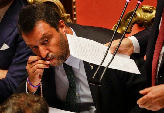 In this Aug. 20, 2019, file photo, Italian Deputy-Premier Matteo Salvini kisses a rosary as Premier Giuseppe Conte addresses the Senate in Rome.