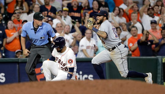 The Houston Astros' Robinson Chirinos is tagged out by Detroit Tigers third baseman Dawel Lugo while trying to stretch a double into a triple during the ninth inning.
