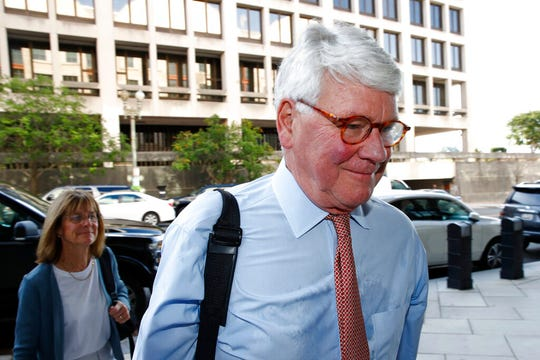 Greg Craig, former White House counsel to former President Barack Obama, walks into a federal courthouse for his trial, Thursday, Aug. 22, 2019, in Washington.