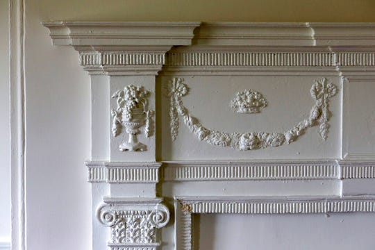 A detailed, original fireplace mantel is seen in the refurbished Lazaretto Quarantine Station Wednesday July 10, 2019, in Essington, Pa.