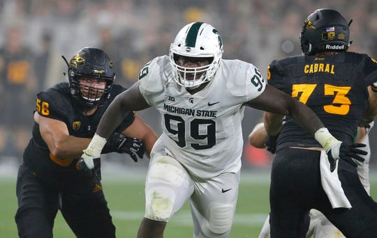 Defensive tackle Raequan Williams (99) was named one of four captains for Michigan State this season.
