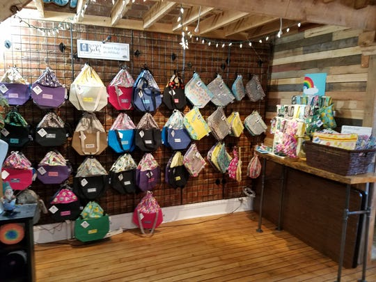 A MidMitten Designs trunk show at a yarn shop. The project bags are available in a variety of styles and sizes, and range from $11-$63.