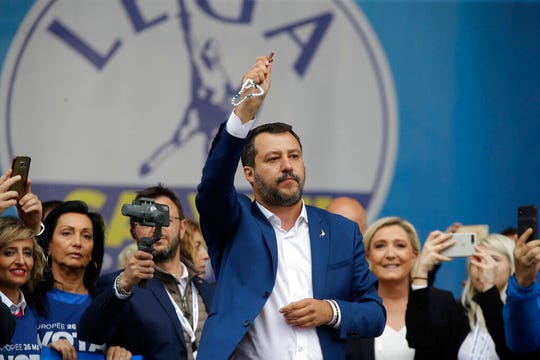 In this file photo taken on May 18, 2019, Matteo Salvini holds a rosary as he gives his speech during a rally organized with leaders of other European nationalist parties. For months now, Salvini -- a divorced father of two children by two different women -- has been kissing rosaries, invoking the Madonna and quoting St. John Paul II at political rallies in a bid to rally Italian Catholics behind his nationalist message.