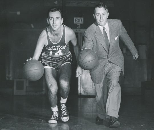 Boston Celtic Bob Cousy is seen with NBC sportscaster Curt Gowdy in this promotional photo from Dec. 16, 1955.