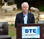 Scott Carter, Detroit Zoological Society chief life sciences officer, announces the partnership with DTE. The zoo will now be powered by 100% renewable energy as they partner with DTE's MIGreenPower initiative.