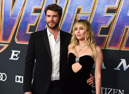 "In this Monday, April 22, 2019, file photo, Liam Hemsworth, left, and Miley Cyrus arrive at the premiere of ""Avengers: Endgame"" at the Los Angeles Convention Center."