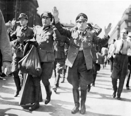 In this Aug.28, 1944 file photo, high ranked German officers, captured by French patriot forces in Paris, are marched through the streets of the French capital with their hands in the air. The fighting for the liberation of Paris took place from August 19 to August 25, 1944.