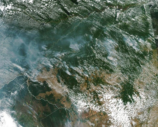 This satellite image provided by NASA on Aug. 13, 2019 shows several fires burning in the Brazilian Amazon forest.  Brazil's National Institute for Space Research, a federal agency monitoring deforestation and wildfires, said the country has seen a record number of wildfires this year, counting 74,155 as of Tuesday, Aug. 20, an 84 percent increase compared to the same period last year.