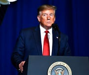 President Donald Trump addresses the audience at the 75th annual AMVETS National Convention in Louisville, Ky. on Wednesday.
